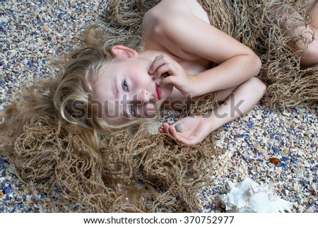 Fantasy. beautiful girl mermaid with fish tail and long developing hair swimming in the sea under water  - stock photo