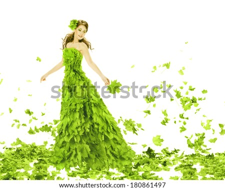 Fantasy beauty, fashion woman in seasons spring leaves dress. Creative beautiful girl turning in green summer gown, over white background.  - stock photo