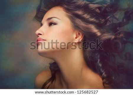 fantasy beauty portrait of a young dark skin woman - stock photo
