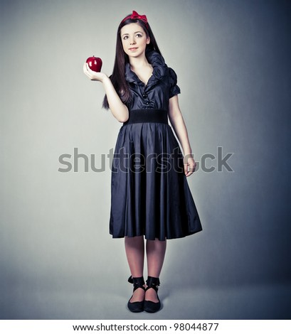 fantasy portrait of the beautiful Snow White with an apple - stock photo