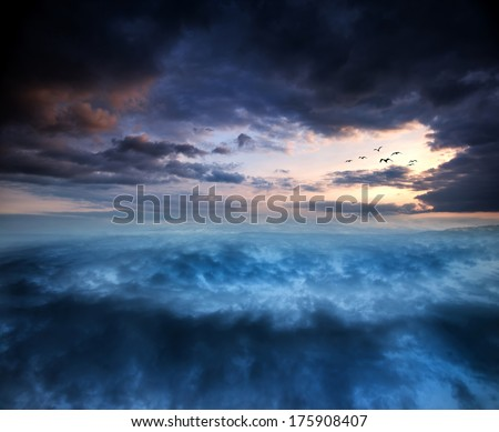 Fantasy skyscape sunset over surreal vortex formation - stock photo