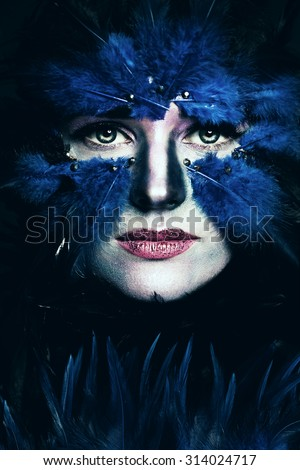 Fantasy Stage Makeup. Woman with Art Makeup. Blue Bird Face - stock photo