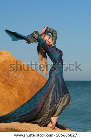 Fantasy style portrait of woman in blue dress - stock photo