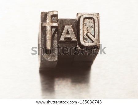 FAQ letters with vintage grunge letterpress type - stock photo