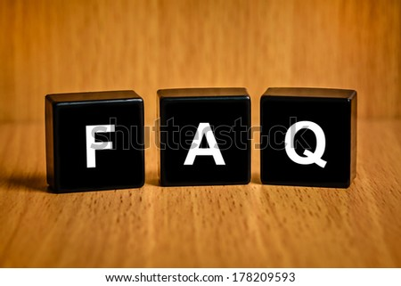 FAQ or Frequently asked questions text on black block - stock photo