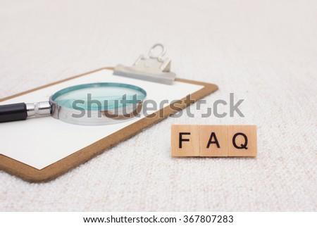 FAQ spelled with wood blocks - stock photo