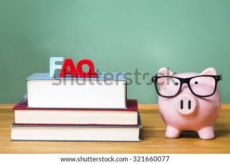 FAQ theme with pink piggy bank with chalkboard in the background as concept image of the costs of education - stock photo