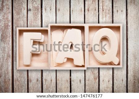 FAQ wood word style - stock photo