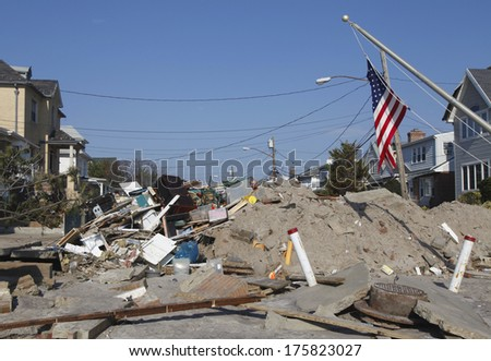 FAR ROCKAWAY, NY - NOVEMBER 11: Destroyed beach house in the aftermath of Hurricane Sandy on November 11, 2012 in Far Rockaway, NY. Image taken 12 days after Superstorm Sandy hit New York - stock photo