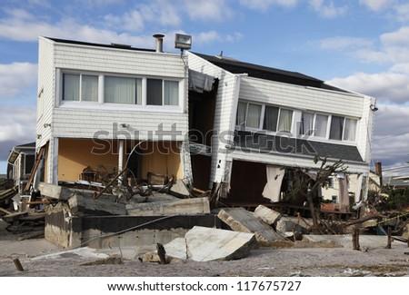 FAR ROCKAWAY, NY - NOVEMBER 4: Destroyed beach houses in the aftermath of Hurricane Sandy on November 4, 2012 in Far Rockaway, NY - stock photo