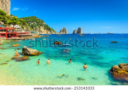 Faraglioni cliffs and wonderful beach in Capri island,Italy,Europe - stock photo