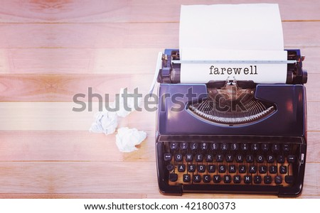 Farewell message on a white background against typewriter with paper on table in office - stock photo