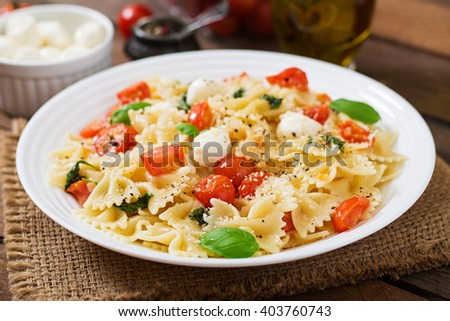 Farfalle Pasta - Caprese salad with tomato, mozzarella and basil - stock photo