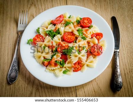 Farfalle pasta with cherry tomatoes - stock photo