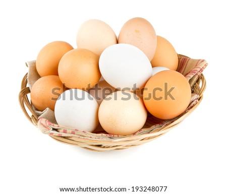 farm eggs in a basket over white - stock photo