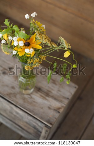 farm flowers in glass vase jar  - unpainted wood - stock photo