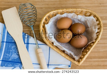 Farm Fresh Brown Chicken Hen Eggs in a Basket on Rustic - stock photo