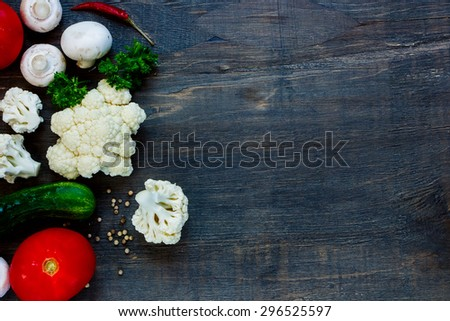 Farm fresh vegetables, herbs and mushrooms on rustic wooden background with space for text. Vegetarian food, health or cooking concept. - stock photo