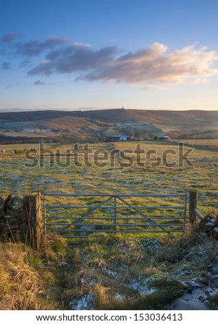 farm gate and fields in yorkshire in winter - stock photo
