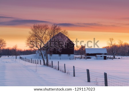 Farm house and barn on early morning winter landscape - stock photo