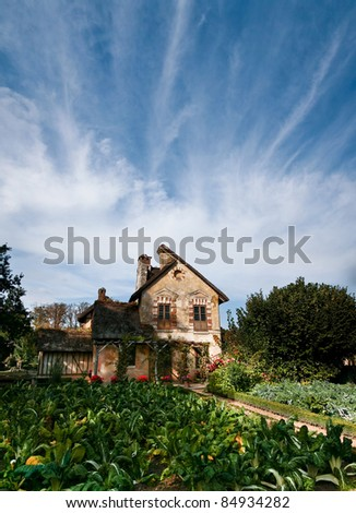 Farm house built by Marie Antoinette on Versailles grounds - stock photo