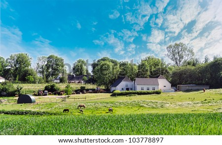 Farm house in Denmark, with horses and machines - stock photo
