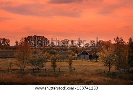 Farm in sunset - stock photo