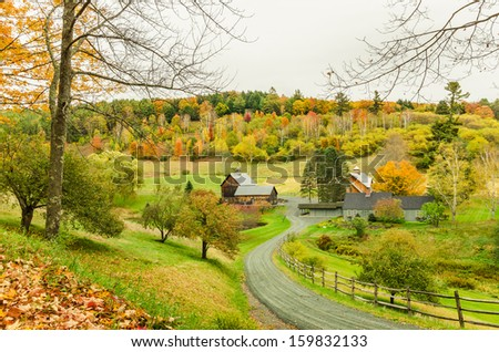 Farm in the Autumn Landscape and Cloudy Sky - stock photo