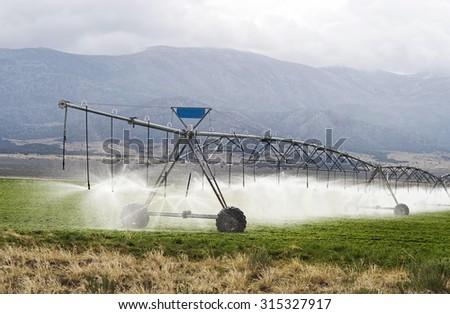 Farm irrigation in Utah. - stock photo
