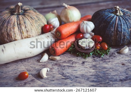 Farm market photo with different vegetables and greens. Organic products and healthy lifestyle photography. Fresh food on the wooden background.  - stock photo