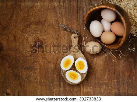 Farm natural organic eggs on a wooden background - stock photo