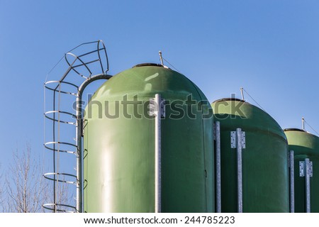farm silos for fish farming/agricultural silos for the storage of feed - stock photo