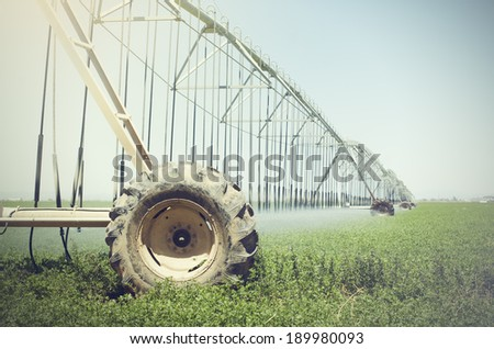 Farm watering irrigation machine system for growing crops - stock photo