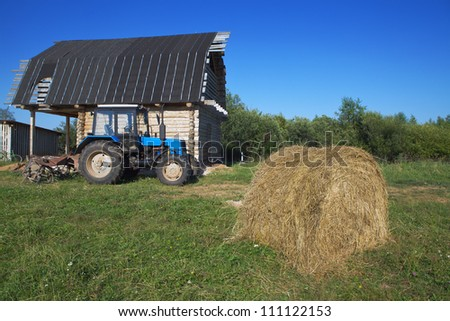 Farm with a tractor in the yard - stock photo