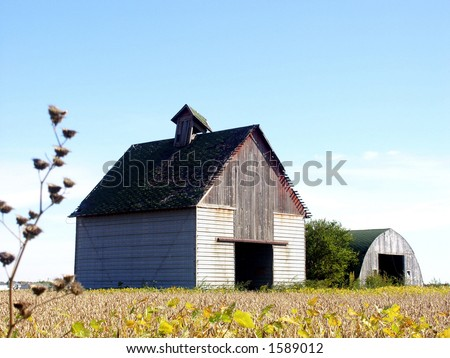 Farmer's corn crib and shed after the harvest on Midwestern farm, Illinois - stock photo