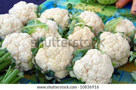 farmer's market cauliflower display on a colorful tablecloth - stock photo