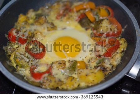 Farmers breakfast with egg organic food fried in pan  Top view image at farmers breakfast with assorted vegetable like paprika chili sugar snap potato pepper ideal for food blog - stock photo