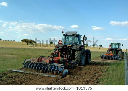Farmers cultivating - stock photo