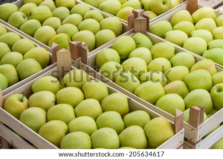 Farmers market apples in a wooden crates. At the farmers market local growers come and sell their freshly picked crops at reasonable prices. Selective focus.  - stock photo