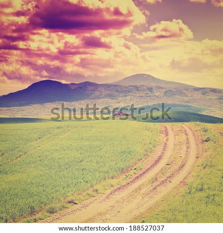 Farmhouse and Green Sloping Meadows of Tuscany, Instagram Effect - stock photo
