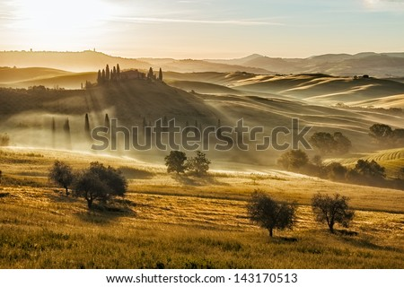 Farmhouse in Val d'Orcia after sunset, Tuscany, Italy - stock photo