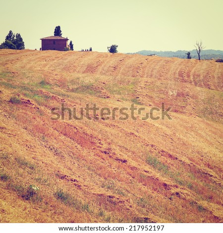 Farmhouse Surrounded by Sloping Meadows of Tuscany in Italy, Instagram Effect - stock photo