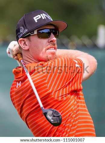 FARMINGDALE, NY - AUGUST 21: Hunter Mahan hits a drive at Bethpage Black during the Barclays on August 21, 2012 in Farmingdale, NY. - stock photo
