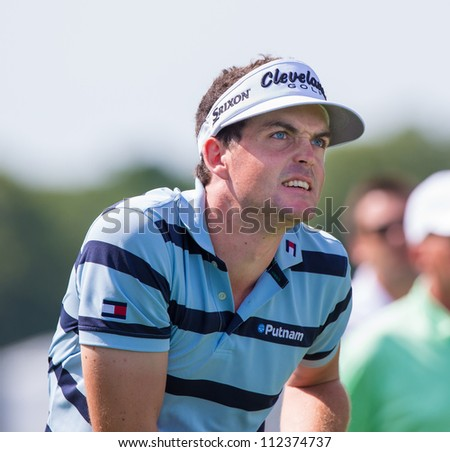 FARMINGDALE, NY - AUGUST 21: Keegan Bradley watches his drive at Bethpage Black during the Barclays on August 21, 2012 in Farmingdale, NY. - stock photo