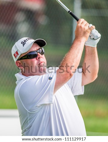 FARMINGDALE, NY - AUGUST 21: Kevin Stadler hits a drive at Bethpage Black during the Barclays on August 21, 2012 in Farmingdale, NY. - stock photo