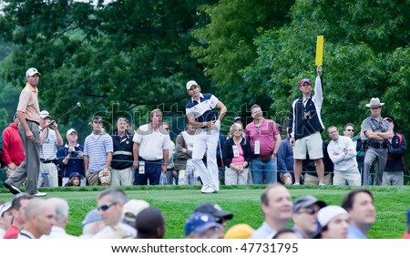 FARMINGDALE, NY - JUNE 16: Columbian Camilo Villegas drives off the 5th hole on the Black course during the 2009 US Open on June 16, 2009 in Farmingdale, NY. Matt Kutchar looks on. - stock photo