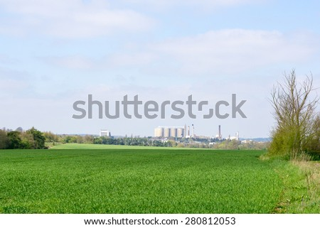 Farmland and sugar beet fatctory in the background in bury St Edmunds, Suffolk, England - stock photo