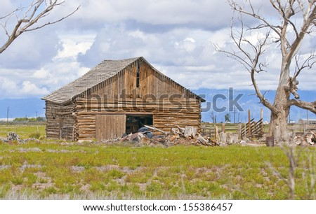 Farmland in America with Old Barn - stock photo