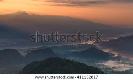 Farmlands on a misty morning - stock photo