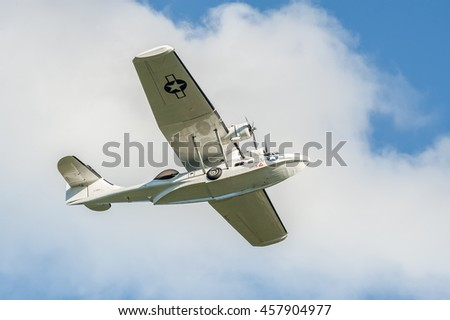 FARNBOROUGH, UK - JULY 17: Beautifully restored vintage WW2 PBY Catalina flying boat in the skies over Farnborough, UK on July 17, 2016 - stock photo